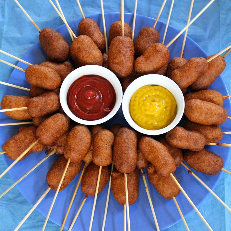 Because of the corn dog's American summertime past, we recommend complementing corn dogs with classic summertime BBQ foods. These might include watermelon, coleslaw, pasta salad, baked beans, corn on the cob, green salad, and green beans.