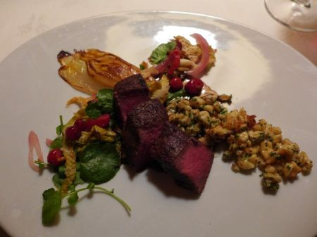 Main Course: Juniper Crusted Venison Loin on a Tangle of Tart Greens with Caramelized Endive and Mustard Spatzle