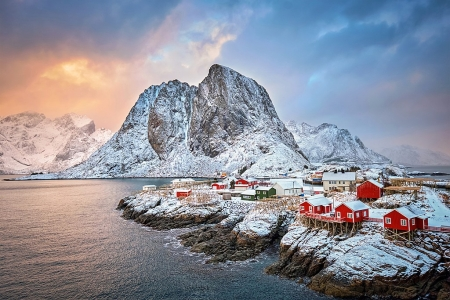 Famous tourist attraction Hamnoy fishing village on Lofoten Islands, Norway with red rorbu houses. W